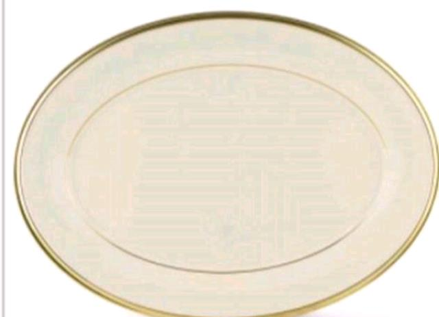 Where to find 9  Oval Platter  Ivory in Concord